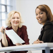 Businesswomen smiling — Stock Photo