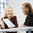 Stock Photo: Businesswomen smiling