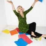 Businesswoman throwing folders — Stock Photo