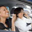 Laughing women in car. - Zdjęcie stockowe
