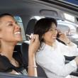 Laughing women in car. - Stockfoto