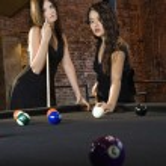 Women playing billiard game. — Stock Photo