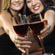 Stock Photo: Women toasting wine glasses