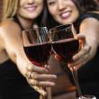 Women toasting wine glasses — Stock Photo