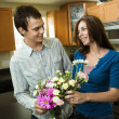 Young couple with flowers — Stock Photo
