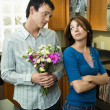 Boyfriend begging forgiveness - Stockfoto