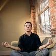Man in lotus pose — Stock Photo