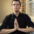 Man in meditation pose — Stock Photo