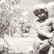 Infrared cherub statue at graveyard. — Stock Photo #9311881