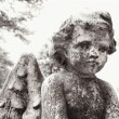 Cherub statue in graveyard — Stock Photo #9311897