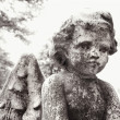 Cherub statue in graveyard - Stock Photo