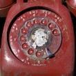 Stock Photo: Old red rotary phone.