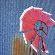 Broken windmill against blue background. - Stok fotoğraf