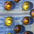 Old taillights on blue siding. - Stock Photo