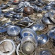 Old hubcaps on ground - Stock Photo