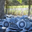 Stock Photo: Piles of hubcaps on ground.