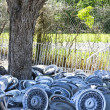 Stock Photo: Stacks of hubcaps on ground.