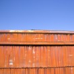 Rusted orange metal and sky. — Stock Photo