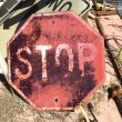 Old rusty stop sign — Stock Photo #9312090