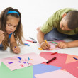 Hispanic boy and girl coloring. — Stock Photo