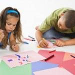 Hispanic boy and girl coloring. — Stock Photo