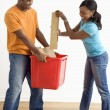 Man and woman recycling. - Stock Photo