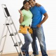 Portrait of couple with ladder. — Stock Photo