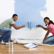 Couple painting wall blue. — Stock Photo #9312383
