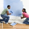 Couple painting wall. — Stock Photo #9312384