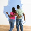 Man and woman looking at paint job. — Stock Photo #9312411