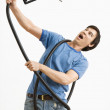 Man attacked by gas nozzle. — Stock Photo