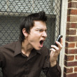 Man screaming at cell phone. — Stock Photo