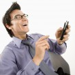 Man laughing at text message. — Stock Photo