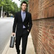Businessman walking in city. — Stock Photo