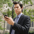 Businessman looking at cell phone. — Stock Photo #9312684