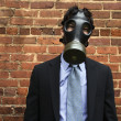 Royalty-Free Stock Photo: Businessman wearing gas mask.