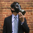 Businessman wearing gas mask. — Stock Photo