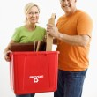 Couple with recycling bin. — Stock Photo