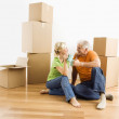 Couple with moving boxes. — Stock Photo