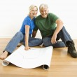Man and woman with blueprints. — Stock Photo