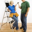Man and woman with tools and ladder. — Stock Photo