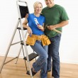 Man and woman with tools and ladder. — Foto Stock