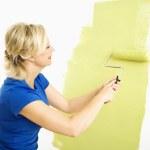 Woman painting wall. — Stock Photo