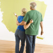 Man and woman observing paint job. — Stock Photo