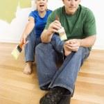 Man pretending to paint woman's toenails. — Stock Photo