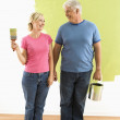 Couple with painting supplies. — Stock Photo #9313048