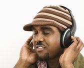 Man listening to headphones. — Stock Photo