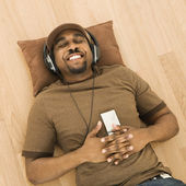 Man relaxing to music. — Stock Photo