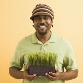 Man holding plant. — Stock Photo