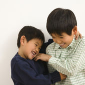 Asian brothers playing — Stock Photo